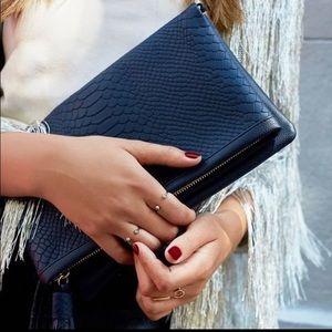 Like new Gigi New York leather convertible bag